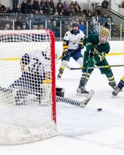 Steven Miller, who scored the overtime winner, shoots wide of Clarkston goalie Jakob Harper during Howell's 3-2 victory in a regional hockey semifinal on Saturday, Feb. 29, 2020.