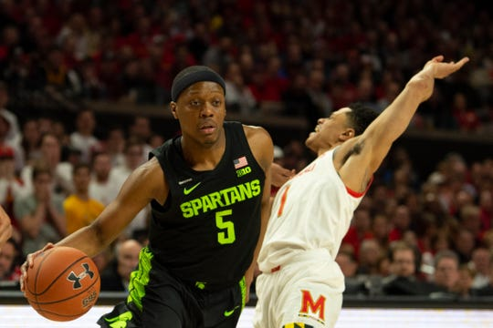 Feb 29, 2020; College Park, Maryland, USA;  Michigan State Spartans guard Cassius Winston (5) dribbles as Maryland Terrapins guard Anthony Cowan Jr. (1) reacts after being founded during the first half at XFINITY Center. Mandatory Credit: Tommy Gilligan-USA TODAY Sports