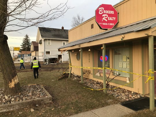 A truck crashed into the front of a real estate office and a house on North East Street Sunday afternoon.