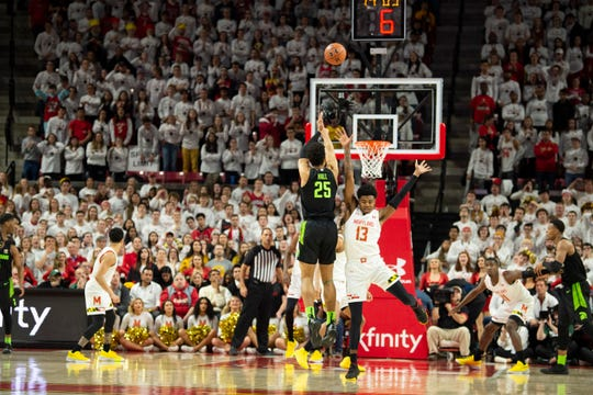 Feb 29, 2020; College Park, Maryland, USA;  Michigan State Spartans forward Malik Hall (25) takes a three point shot as Maryland Terrapins guard Hakim Hart (13) defends during the second half at XFINITY Center. Mandatory Credit: Tommy Gilligan-USA TODAY Sports