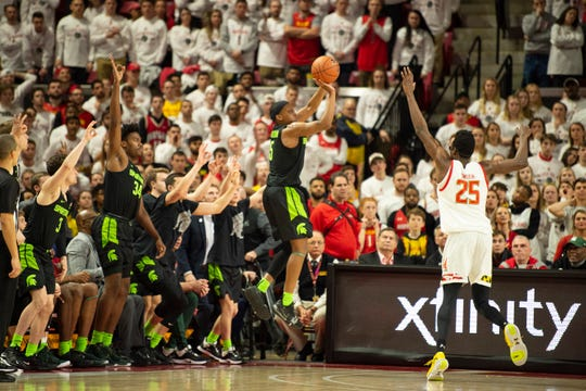 Feb 29, 2020; College Park, Maryland, USA;  Michigan State Spartans guard Cassius Winston (5) takes a three point shot in front of the bench as Maryland Terrapins forward Jalen Smith (25) defends during the second half at XFINITY Center. Mandatory Credit: Tommy Gilligan-USA TODAY Sports