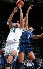 Michigan State's Taiyier Parks, left, and Penn State's Alisia Smith (1) batle for a rebound, Sunday, March 1, 2020, in East Lansing, Mich.