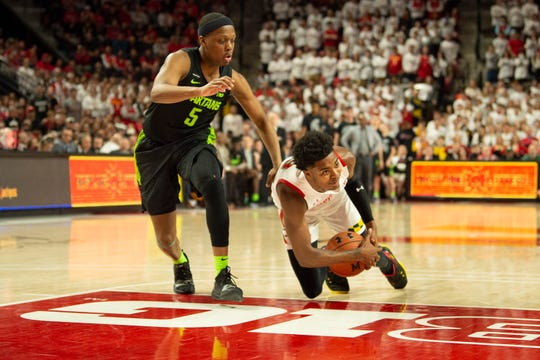 Feb 29, 2020; College Park, Maryland, USA;  Maryland Terrapins guard Hakim Hart (13) falls while dribbling as Michigan State Spartans guard Cassius Winston (5) defends during the second half at XFINITY Center. Mandatory Credit: Tommy Gilligan-USA TODAY Sports