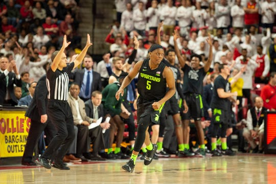 Feb 29, 2020; College Park, Maryland, USA;  Michigan State Spartans guard Cassius Winston (5) reacts after making a three point shot during the second half against the Maryland Terrapins at XFINITY Center. Mandatory Credit: Tommy Gilligan-USA TODAY Sports