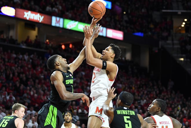Maryland's Aaron Wiggins (shooting) and MSU's Aaron Henry (defending) have become the two headliners for their respective teams since last season's meeting (above) in College Park.