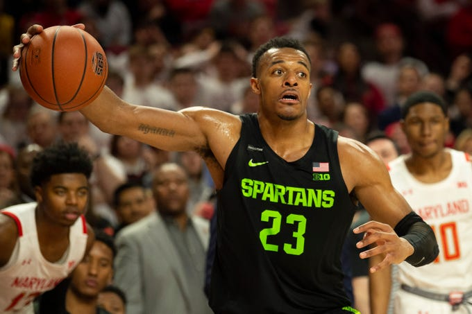 Feb 29, 2020; College Park, Maryland, USA;  Michigan State Spartans forward Xavier Tillman Sr. (23) grabs a loose ball during the second half against the Maryland Terrapins at XFINITY Center. Mandatory Credit: Tommy Gilligan-USA TODAY Sports
