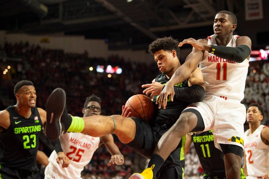 Feb 29, 2020; College Park, Maryland, USA;  Michigan State Spartans forward Malik Hall (25) grabs a rebound away from Maryland Terrapins guard Darryl Morsell (11) during the second half at XFINITY Center. Mandatory Credit: Tommy Gilligan-USA TODAY Sports