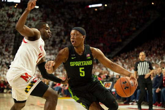 Feb 29, 2020; College Park, Maryland, USA;  Michigan State Spartans guard Cassius Winston (5) makes a move to the basket as Maryland Terrapins guard Darryl Morsell (11) defends during the first half at XFINITY Center. Mandatory Credit: Tommy Gilligan-USA TODAY Sports