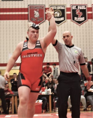 Crestview's Caden Hill has his hand raised after winning a sectional title this season