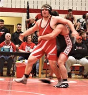Plymouth's Dylan Van Fleet tries to escape the grasp of Mohawk's James Clouse in their 220 pound title match
