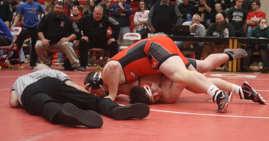 Crestview's Caden Hill, the No. 1-ranked Division III heavyweight in Ohio, pins New London's Josh Logan in 50 seconds to win a sectional title at Plymouth