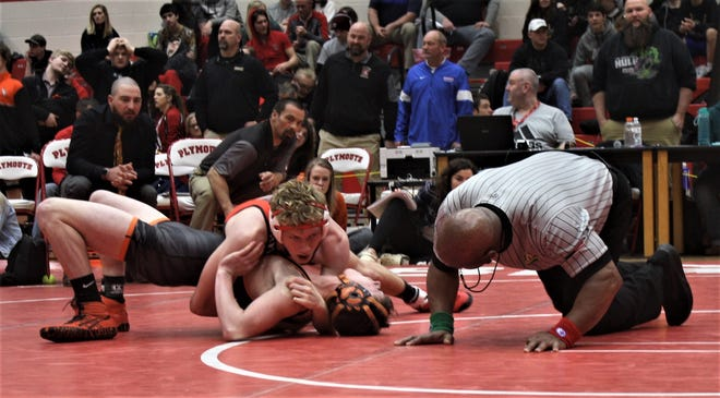 Crestview's Kage Briggs on the verge of pinning his opponent in last year's Division III sectional tournament at Plymouth.