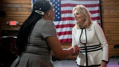 Toni Doss-White (left) shakes hands with Jill Biden on Sunday, March 1, 2020, during a campaign stop at Loflin Yard in Memphis.