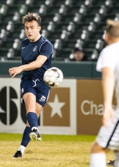 Memphis 901 midfielder Jose Baxter kicks the ball during a game at AutoZone Park on Saturday, February 29, 2020.