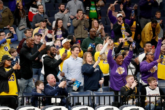 Fans cheer as the Lakers take the court to warm up Saturday, Feb. 29, 2020, before a game against the Grizzlies at FedExForum in downtown Memphis.