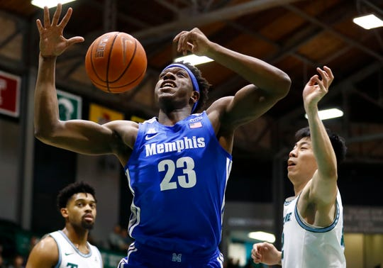 Memphis Tigers center Malcolm Dandridge battles for the ball against Tulane Green Wave forward Kevin Zhang during their game at the Fogelman Arena in Devlin Fieldhouse on Saturday, Feb. 29, 2020.