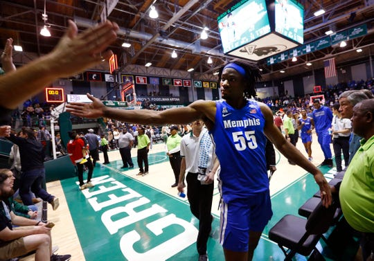 Memphis Tigers forward Precious Achiuwa high-fives fans after their 74-67 overtime win against Tulane at the Fogelman Arena in Devlin Fieldhouse on Saturday, Feb. 29, 2020.