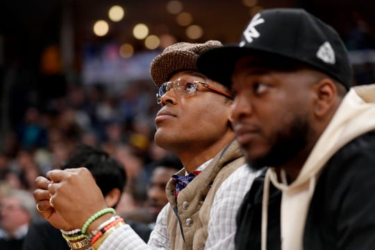 Cam Newton (left) watches as the Grizzlies take on the Lakers on Saturday, Feb. 29, 2020, during a game at FedExForum in downtown Memphis.