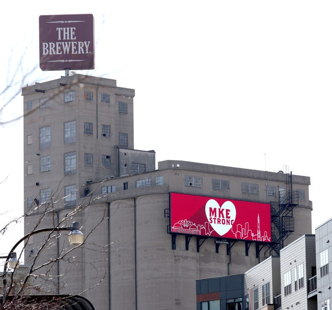 A billboard that hangs on former grain silos at what used to be the Pabst complex, now known as The Brewery, reads MKE Strong in Milwaukee on Sunday in response to the fatal shooting at the Molson Coors facility.