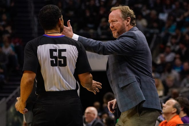 Bucks head coach Mike Budenholzer has some words with referee Bill Kennedy during the second half.