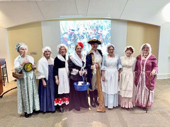 """The Captain Nathan Watkins Chapter of the Daughters of the American Revolution (DAR) recently helped history come to life for the students in Arkansas State University-Mountain Home's """"From Colonies to Country: The History of the American Revolution"""" class. Pictured from left are Jo Anne Dukes, April Baily, Janet Emery, Caroline Carroll, Jill Brown, Janet Mayo, Charlotte Barnhart and Juanita Medley."""