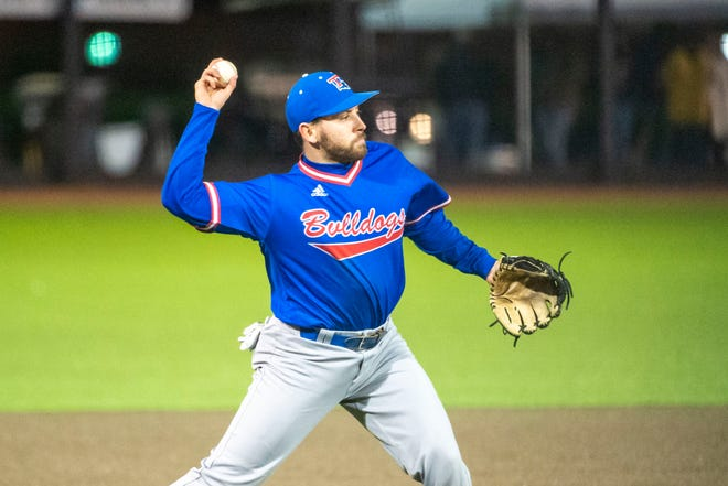 Louisiana Tech infielder Hunter Wells (9) throws to first for an out during an NCAA college baseball game between Louisiana Tech and Troy, Friday, Feb. 21, 2020, in Troy, Ala. (AP Photo/Vasha Hunt)