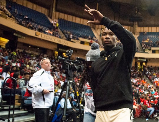 Former Lee star and Alabama football player Henry Ruggs III joins the crowd during the Class 7A boys state championship at Legacy Arena in Birmingham, Ala., on Saturday, Feb. 29, 2020. Mountain Brook leads Lee 21-12 at halftime.