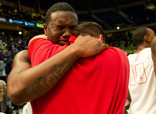 Lee's Deyunkrea Lewis (5) hugs a coach after the game during the Class 7A boys state championship at Legacy Arena in Birmingham, Ala., on Saturday, Feb. 29, 2020. Lee defeated Mountain Brook 40-38.