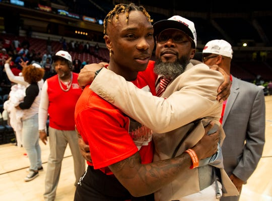 Former Lee and Alabama player Henry Riggs III hugs Lee coach Bryant Johnson during the Class 7A boys state championship at Legacy Arena in Birmingham, Ala., on Saturday, Feb. 29, 2020. Lee defeated Mountain Brook 40-38.