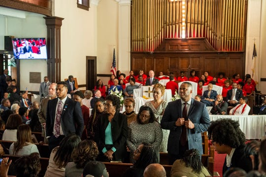 A group of guest stand and face the opposite way as Presidential candidate Mike Bloomberg speaks during the Jubilee at Brown Chapel AME Church in Selma, Ala., on Sunday, March 1, 2020.