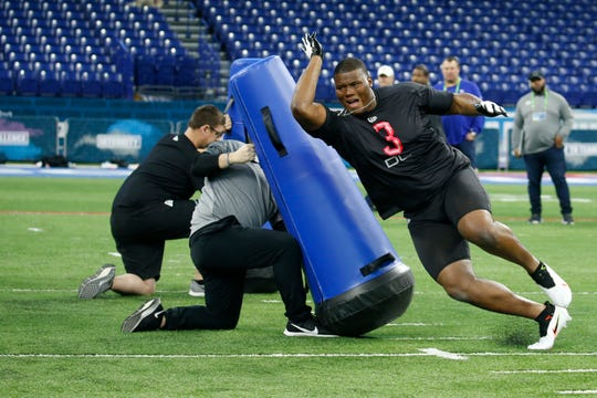 Feb 29, 2020; Indianapolis, Indiana, USA; Auburn Tigers defensive lineman Derrick Brown (DL03) goes through a workout drill during the 2020 NFL Combine at Lucas Oil Stadium.
