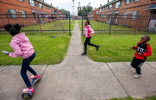 Children play in George Washington Carver Housing beside Brown Chapel AME Church in Selma, Ala., on Sunday March 1, 2020. It is the 55th anniversary of the Selma Bloody Sunday Bridge Crossing.