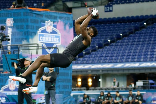 Auburn defensive back Noah Igbinoghene (DB18) goes through a  drill during the 2020 NFL Combine at Lucas Oil Stadium on March 1, 2020, in Indianapolis.