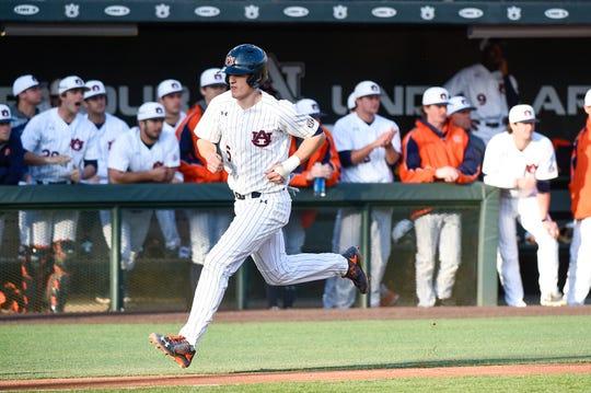 Auburn catcher Matt Scheffler scores a run against Wright State on Friday, Feb. 28, 2020.