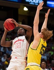 Robert E. Lee's Duke Miles (15) goes up for a layup during the Class 7A boys state championship at Legacy Arena in Birmingham, Ala., on Saturday, Feb. 29, 2020.