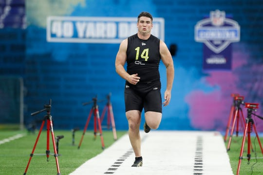 Feb 28, 2020; Indianapolis, Indiana, USA; Auburn Tigers offensive lineman Jack Driscoll (OL14) runs the 40 yard dash during the 2020 NFL Combine at Lucas Oil Stadium.