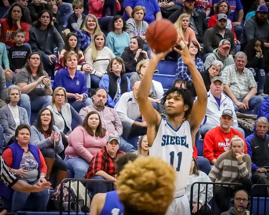 Siegel's Martise Jackson fires a jumper during a 77-53 win over Lincoln County Saturday in the Region 4-AAA quarterfinals.