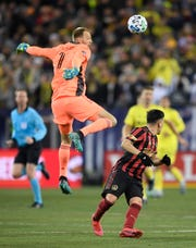 Nashville SC goalkeeper Joe Willis (1) goes up to stop an Atlanta United shot during the second half at Nissan Stadium in Nashville, Tenn., Saturday, Feb. 29, 2020.