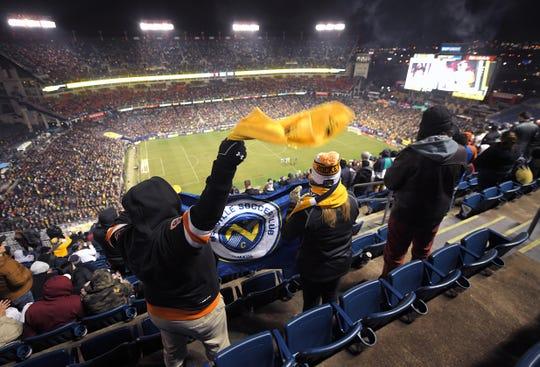 Charlie and Tracy Saunier of Nashville cheer near the top of Nissan Stadium before kickoff of Nashville SC-Atlanta United game in Nashville, Tenn., Saturday, Feb. 29, 2020.