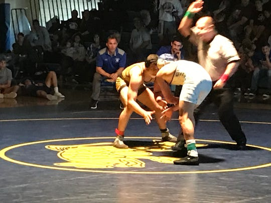 Golden Gate's Andy Martinez and Barron Collier's Dominic Pappalardo square off in the 160-pound final at the Class 2A-Region 3 wrestling meet at Charlotte High School on Saturday. Martinez remained unbeaten at 55-0 with a 3-2 decision.