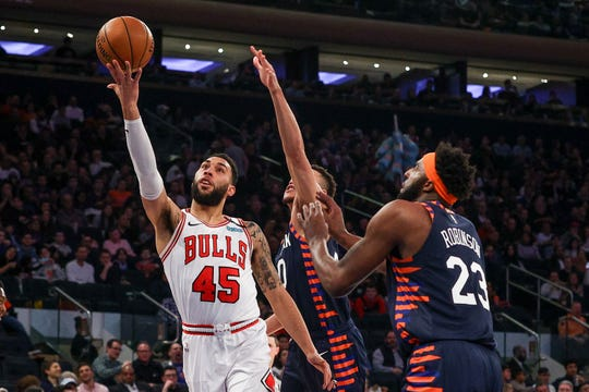 Feb 29, 2020; New York, New York, USA; Chicago Bulls guard Denzel Valentine (45) lays up the ball up in front of New York Knicks guard Kadeem Allen (0) and center Mitchell Robinson (23) during the second quarter at Madison Square Garden.