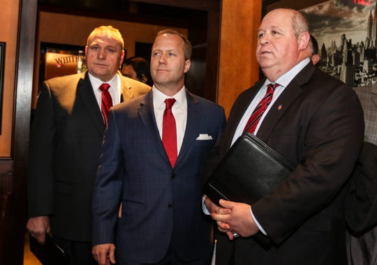 From left, Vincent Ferrara, Louis Valori, and Parsippany Mayor James Barberio await introduction during a party to announce Barberio's run for re-election at Houlihans in Parsippany on February 20, 2017.  Alexandra Pais/ The Daily Record