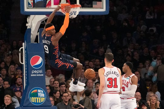 New York Knicks guard RJ Barrett (9) dunks over Chicago Bulls guard Tomas Satoransky (31) during the first half of an NBA basketball game, Saturday, Feb. 29, 2020 in New York.