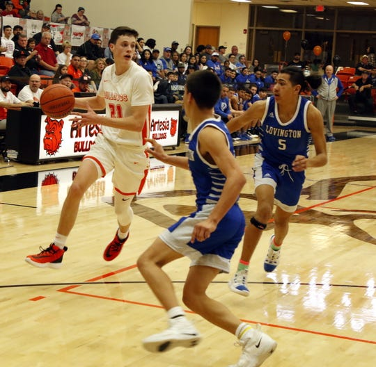 Artesia's Tucker Smotherman looks for a teammate to pass to during the second half of the 4-4A district championship game against Lovington on Feb. 29, 2020. Lovington won, 53-46.