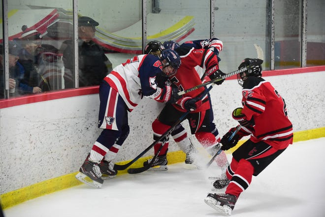 Churchill and Franklin players fight for the puck in a scrum.