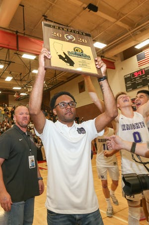 Shadow Hills head coach Ryan Towner holds up the CIF-SS championship trophy after the Knights won their first CIF-SS title by beating Price (Los Angeles) 69-54 on Feb. 29, 2020.