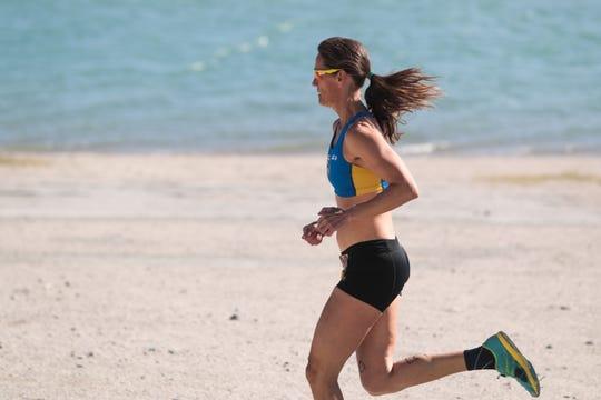 A duathlete participates in the run portion of Desert Triathlon at Lake Cahuilla in La Quinta, Calif. on Sunday, March 1, 2020.