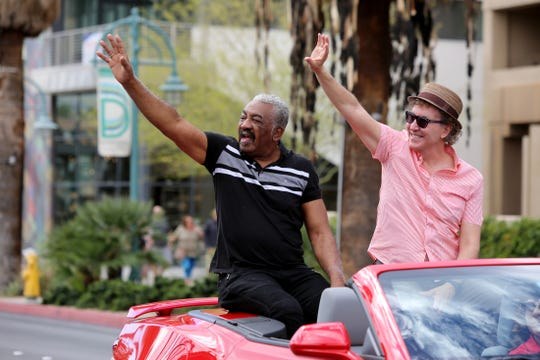 Former City of Palm Springs Mayor Ron Oden and current Mayor Geoff Kors wave to the crowd during the 33rd annual Black History Parade in Palm Springs, Calif., on Saturday, February 29, 2020.