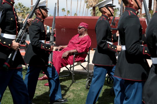 Clifford Reed, center, of Palm Springs watches the Black History Parade in Palm Springs, Calif., on Saturday, February 29, 2020.
