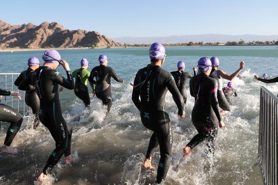 Triathletes enter the swim portion of Desert Triathlon at Lake Cahuilla in La Quinta, Calif. on Sunday, March 1, 2020.